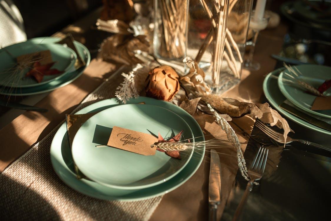 Stainless Steel Fork on Green Ceramic Plate