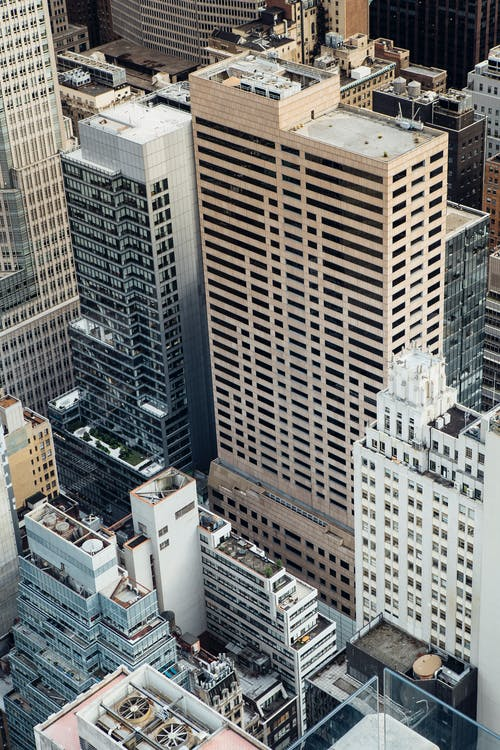 High angle of high rise commerce and residential buildings placed in modern city district in New York in daytime