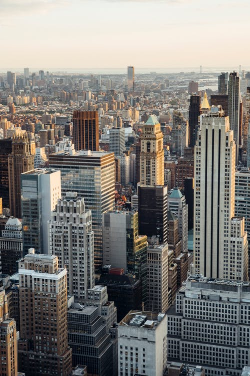 From above of downtown of megapolis with high rise financial and residential buildings located in New York City in daytime