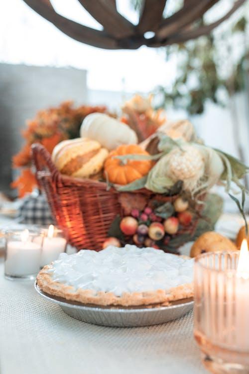 Baked Pumpkin Pie near Basket of Fruits