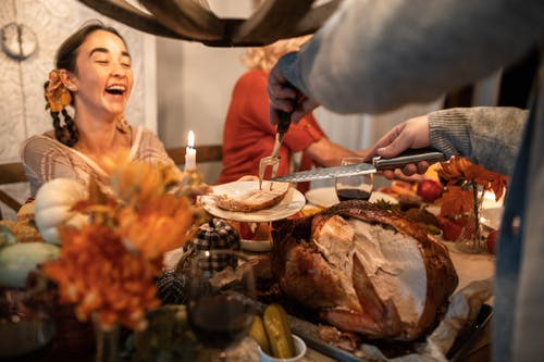 Person Slicing Roasted Turkey