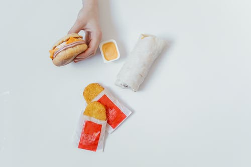 Person Holding White a Breakfast Sandwich