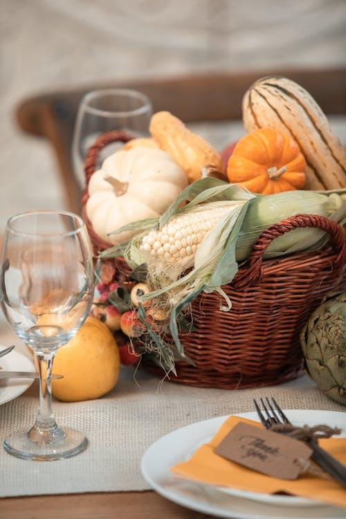 Orange Pumpkins on Brown Woven Basket Beside Clear Wine Glass