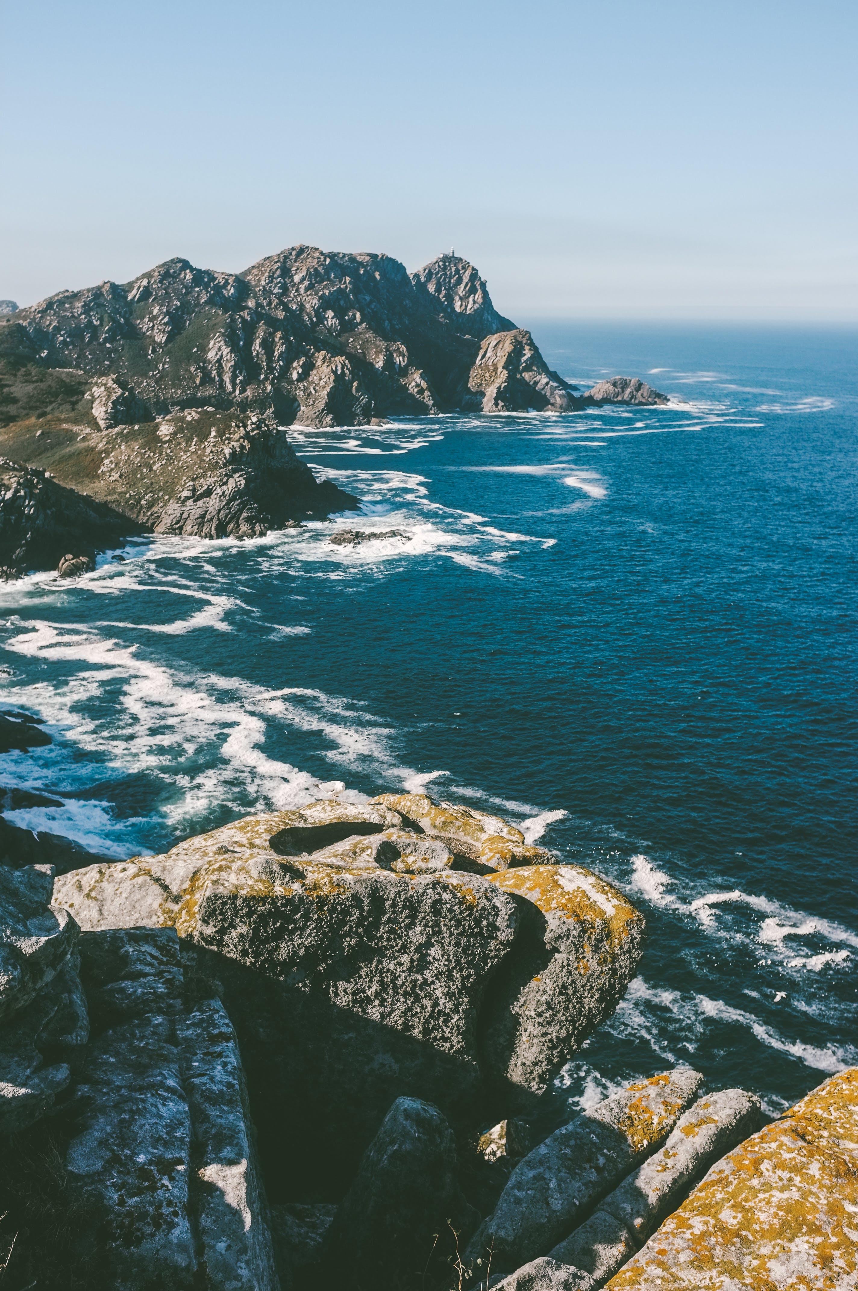 Water Waves Splashing Rocks on Shore