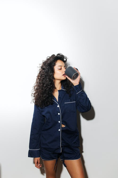 Woman in Black Button Up Jacket Holding Black Camera