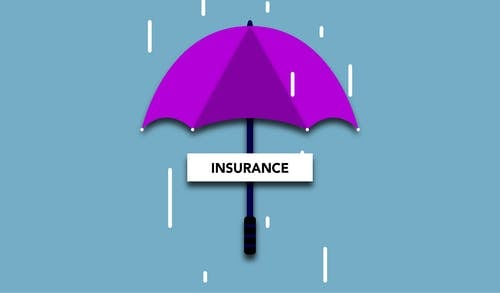 Decorative cardboard illustration of signboard with Insurance title under umbrella in rain on blue background