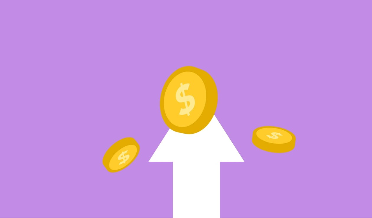 Decorative cardboard appliques of arrow and dollar coins representing income concept on violet background