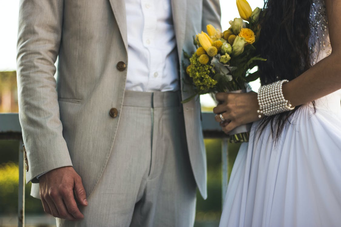Woman Wearing White Dress And Holding Bouquet