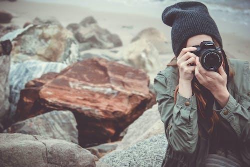 Woman Taking Photo Using Canon Dslr Camera