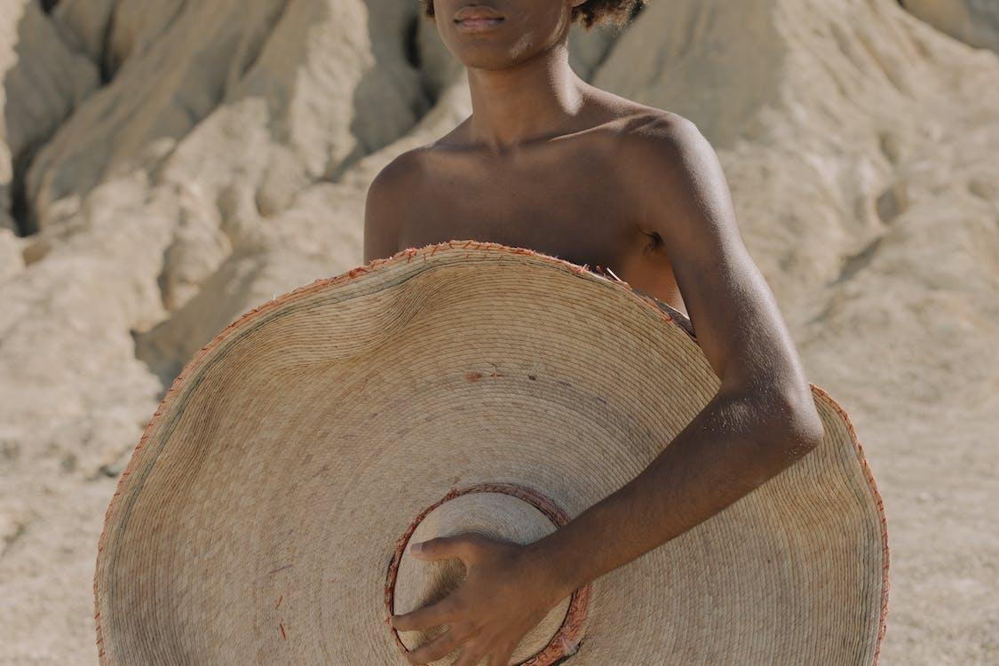 Woman in Brown Sun Hat
