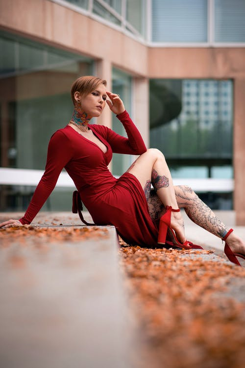 Woman in Red Dress Sitting on Floor