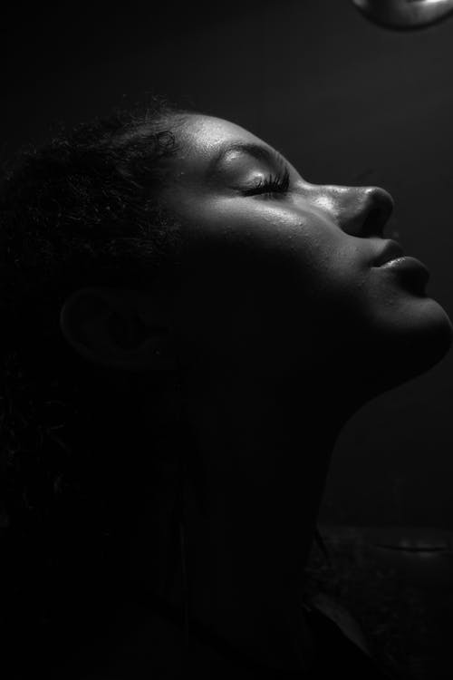 A Grayscale Photo of a Woman's Face