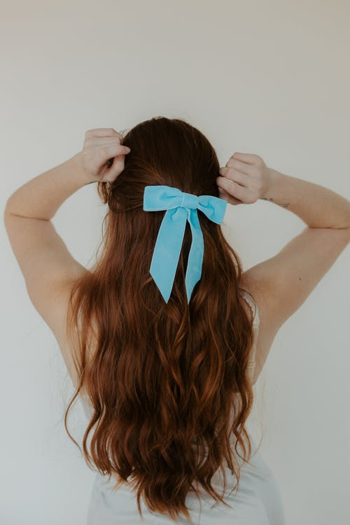Woman in Blue Bow Tie