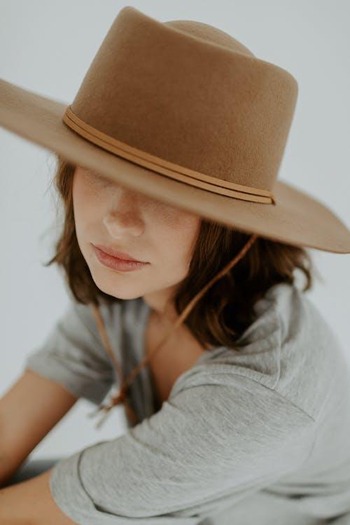 Woman in Grey Shirt Wearing Brown Fedora Hat