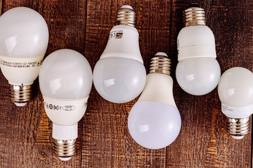 White Light Bulb on Brown Textile