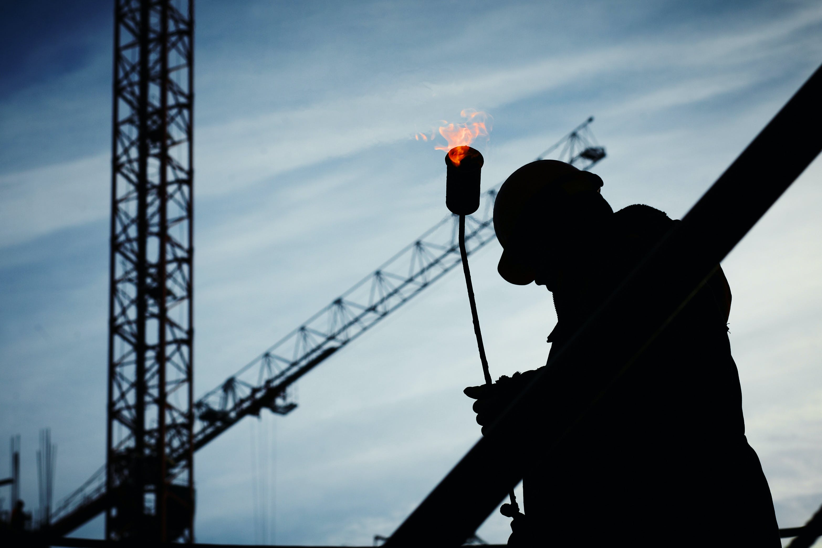 Silhouette of Man Holding Flamethrower