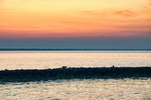 Scenic sunset sky over waving sea
