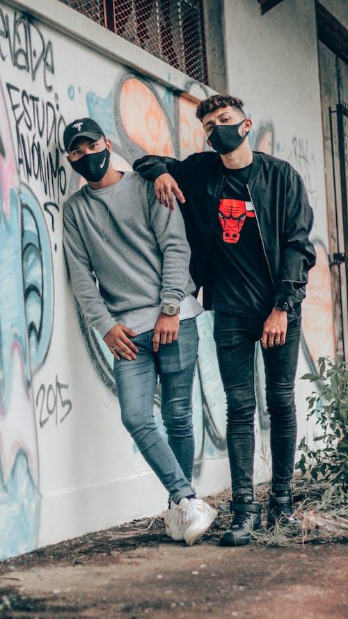 Man in Black and Red Hoodie Beside Man in Gray Jacket