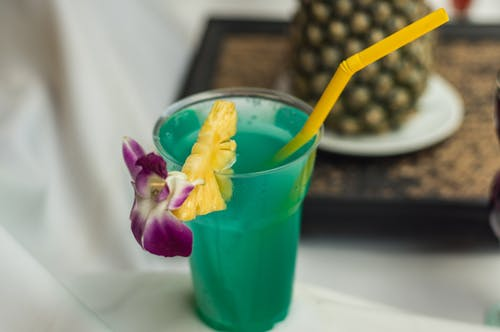 Blue Plastic Cup With Yellow Straw