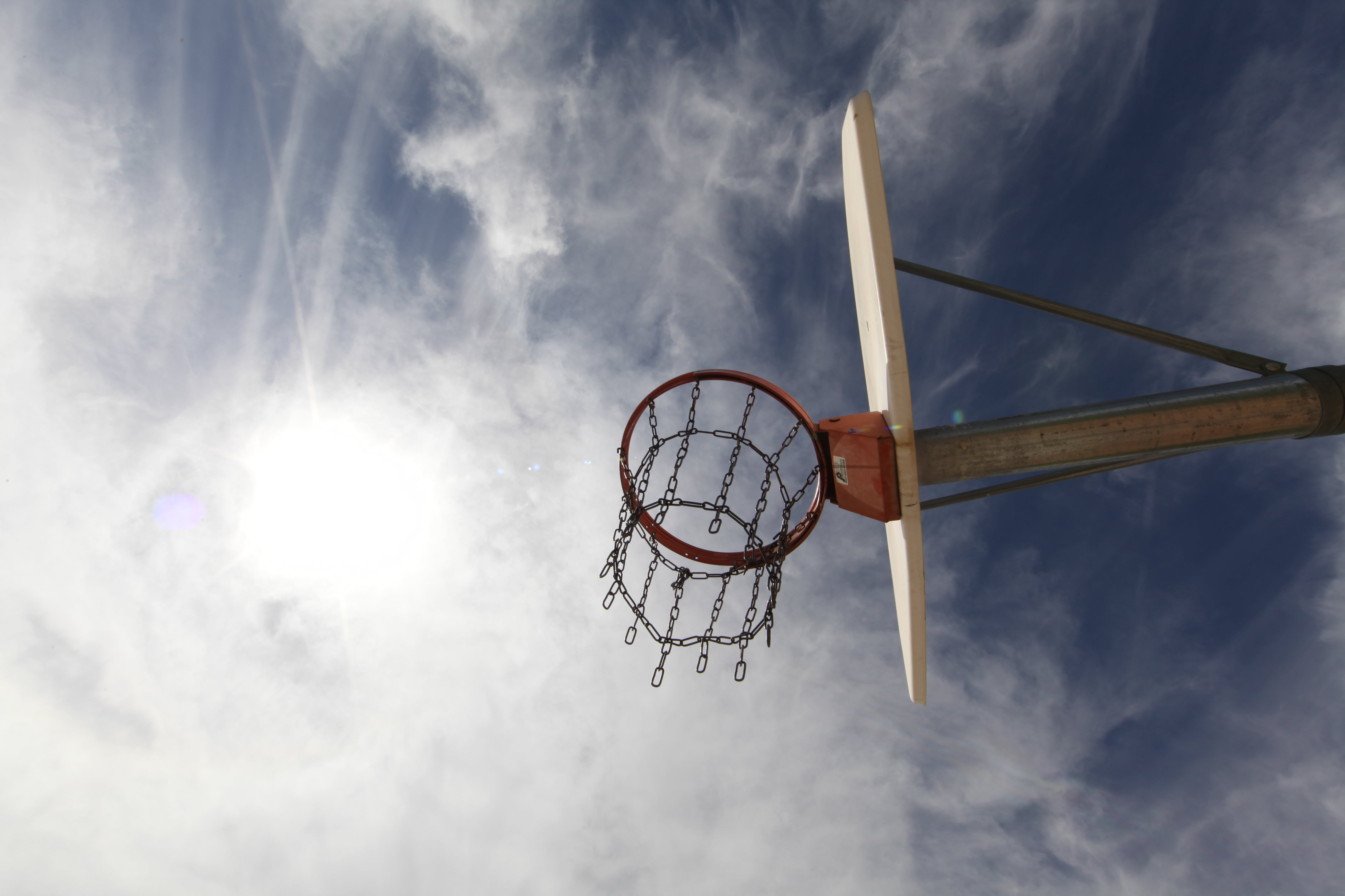 Low-angle Photography of Red and White Basketball System