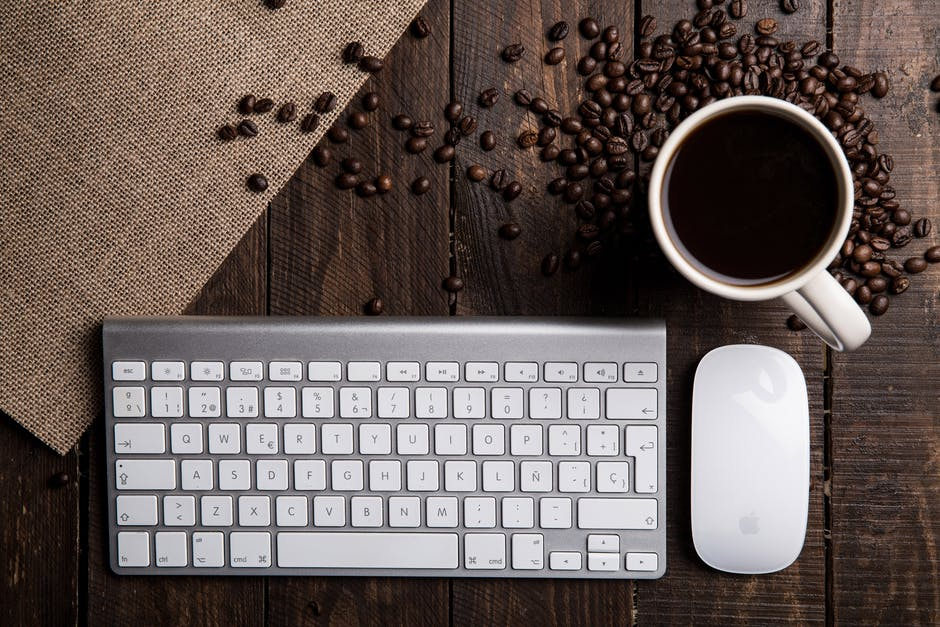 Apple keyboard apple mouse background brown