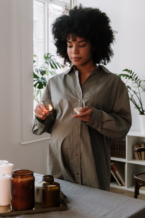 Woman in Gray Coat Holding a Cup of Coffee
