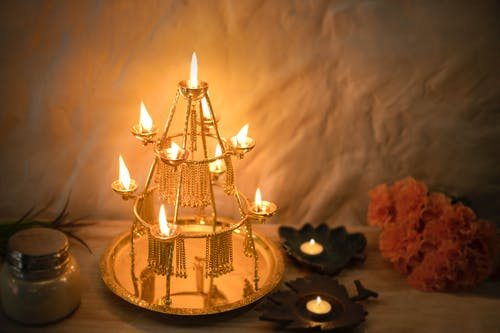 Gold and White Lighted Candle Holder