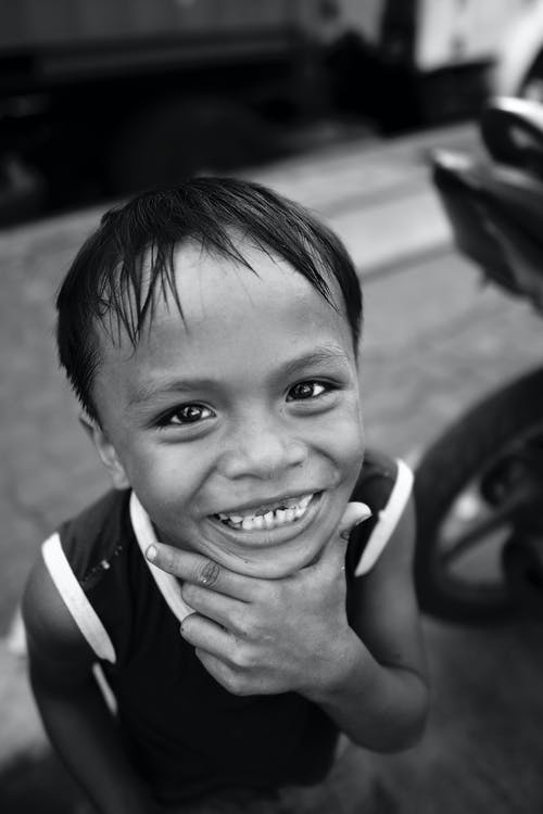 High-Angle Shot of a Boy Smiling and Looking at the Camera
