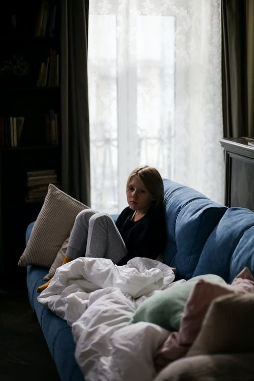 A Boy Sitting on the Couch
