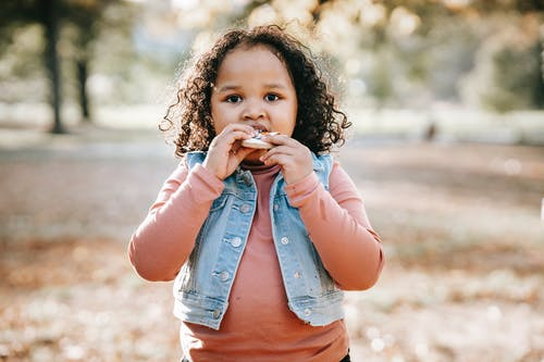 Cute little child with cookie
