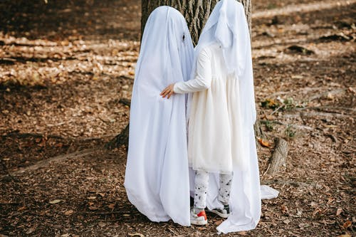 Merry kids in ghost costumes