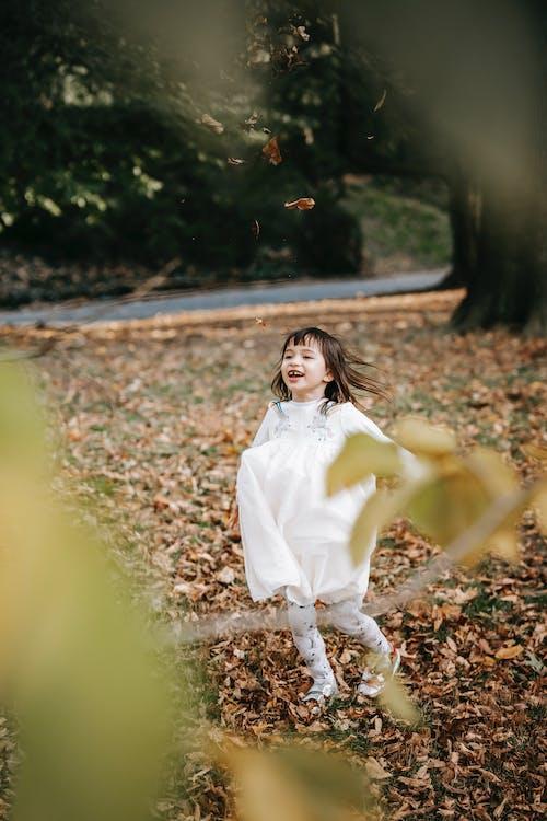 Cute little girl running in park