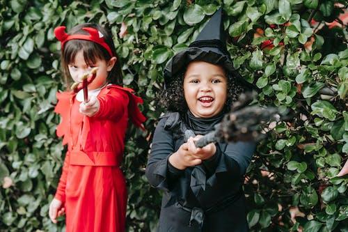 Happy multiethnic little girls on Halloween