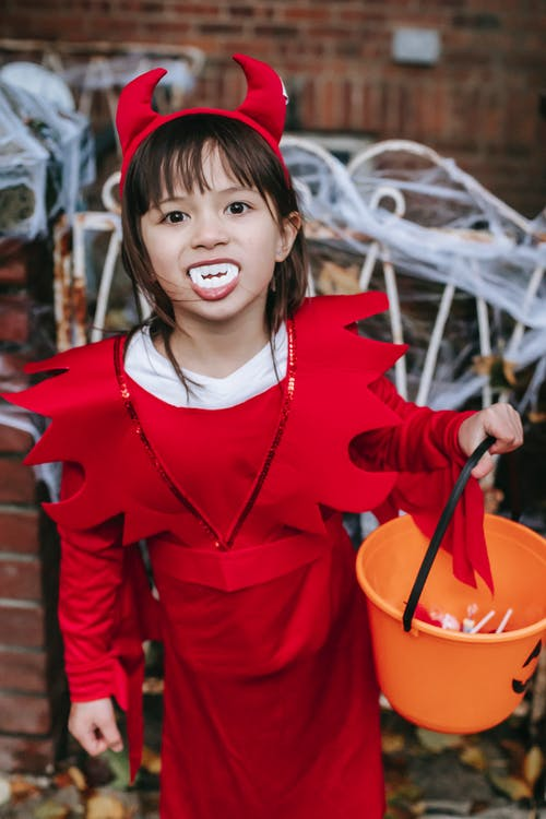 Little girl in costume with candies