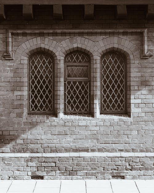 Brown Brick Wall With Brown Wooden Window