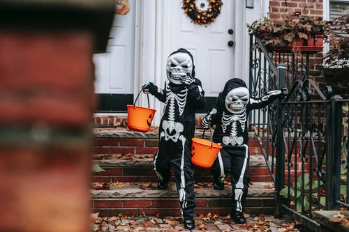 Anonymous kids in Halloween costumes trick or treating