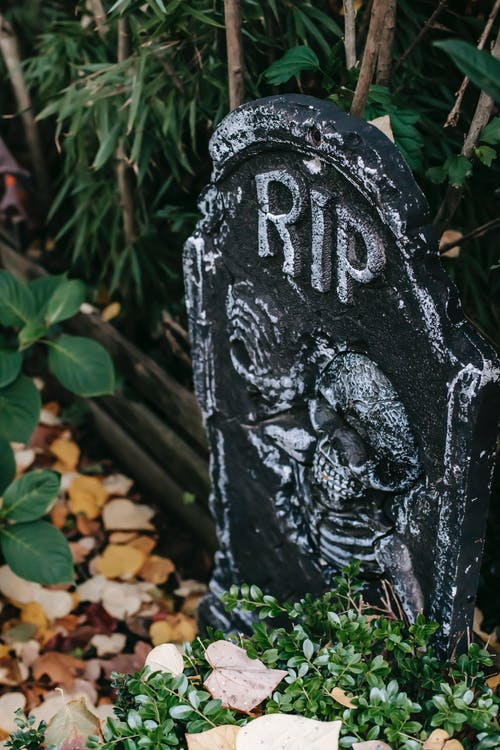 Fake gravestone placed as decoration for Halloween celebration