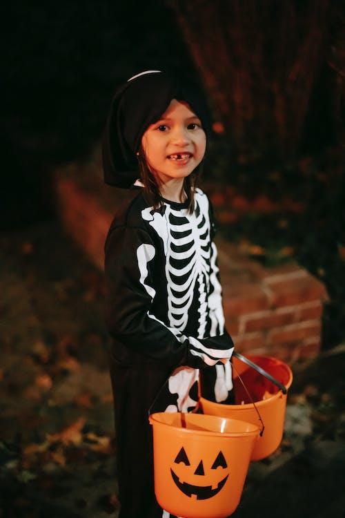 Cute girl in skeleton costume