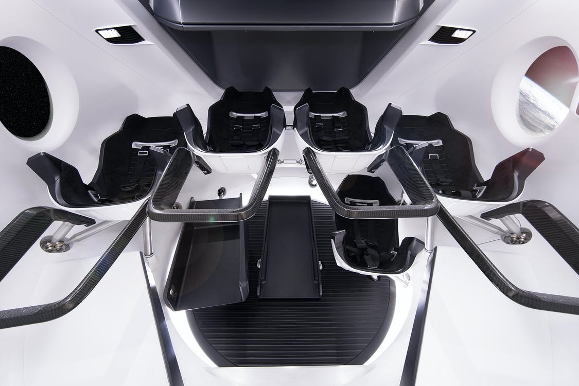 From below of comfortable astronauts chairs inside of modern spacecraft simulator located in modern station