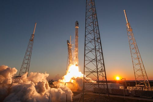 Spacecraft launching into orbit during sundown