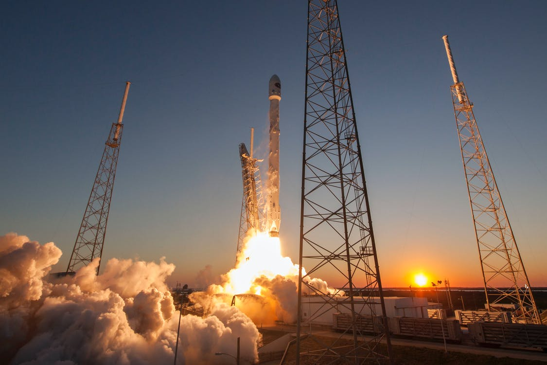 Spacecraft launching into orbit during sundown