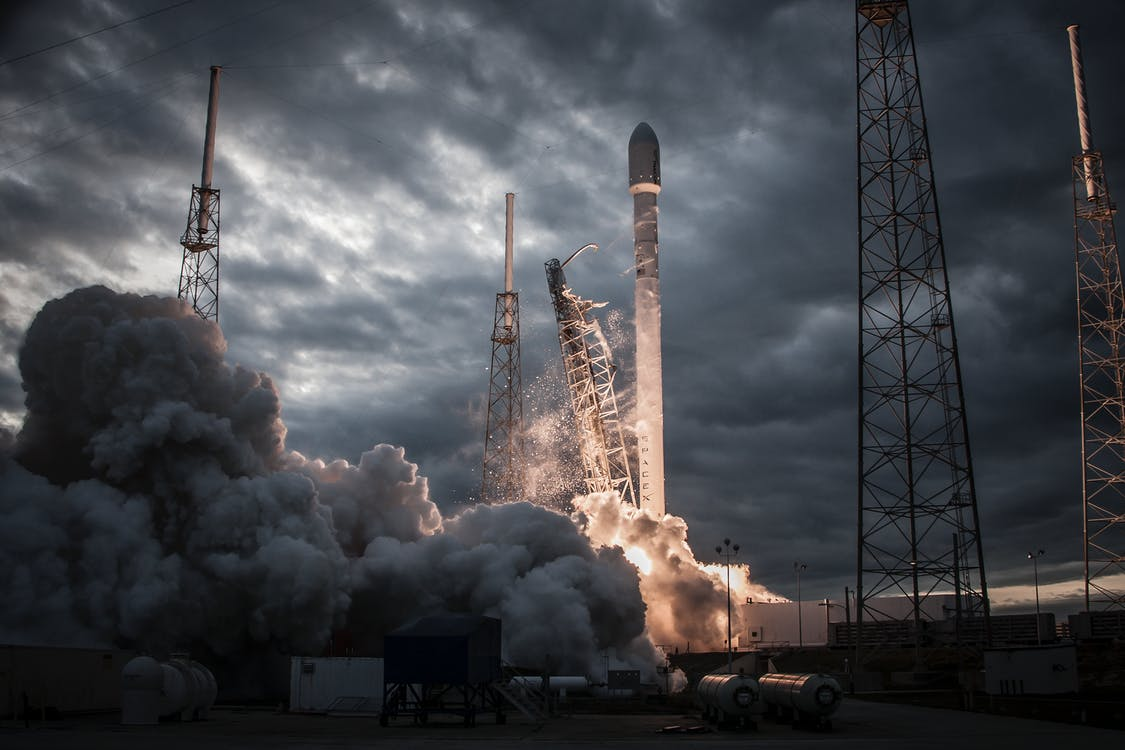 Space rocket taking off on overcast day