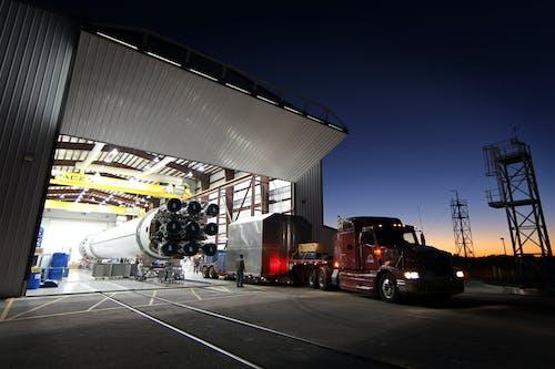 Truck parked near hangar in rocket factory
