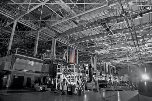 American flag hanging in industrial futuristic factory