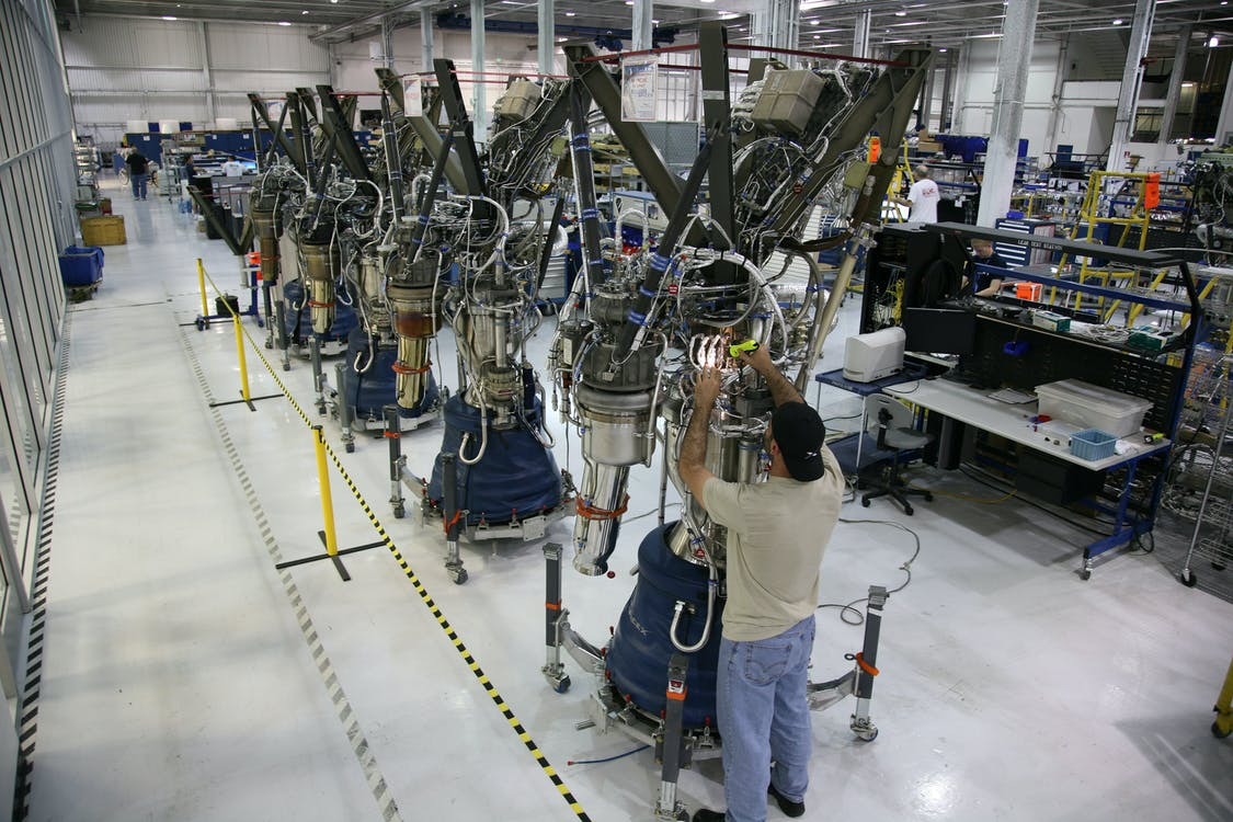 Anonymous mechanic fixing rocket details during assembly