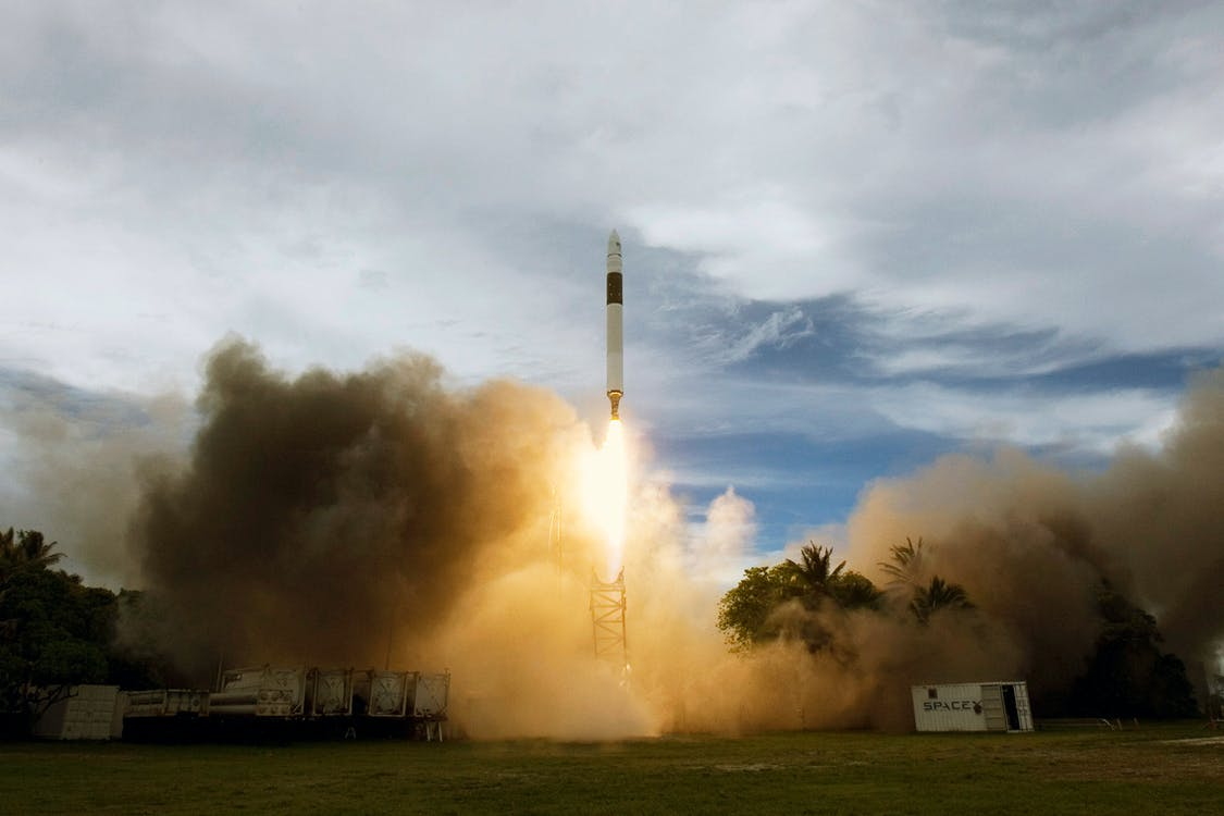 Liftoff of spacecraft on cloudy day