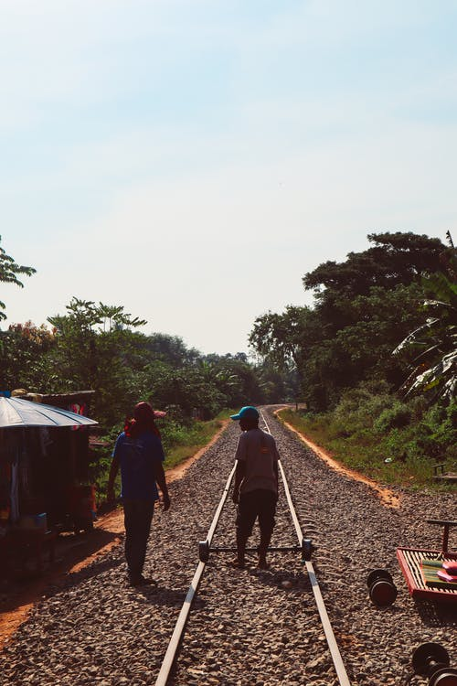 People Walking on Dirt Road