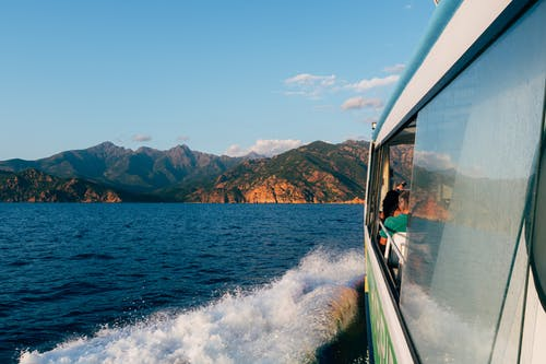 Person in Boat on Sea