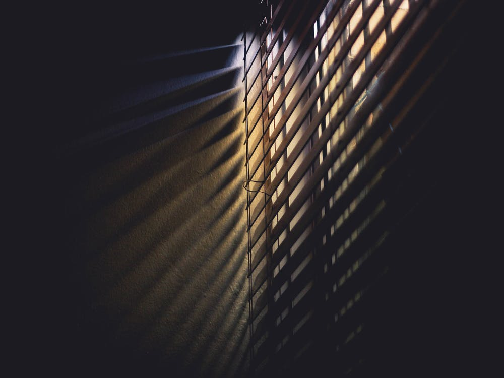 Low Light Photography of Brown Window Blinds