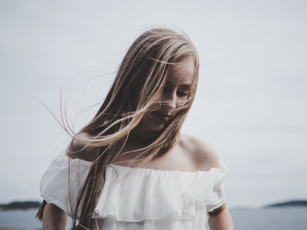 Selective Focus Photography of Woman Wearing White Off-shoulder Top